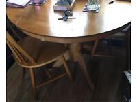 Round table and 4 chairs in pine