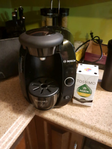Bosch tassimo coffee maker and a pack of coffee discs