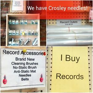 Records Turntables Needles  433 St. Paul St.  WE BUY RECORDS