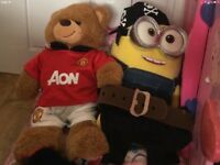 Build a bear. Minion with extra pirate suit. One direction singing bear with football suit