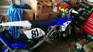 MINT condition 2012 yzf250 trade for 2 smaller bikes or a sled