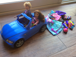 barbie doll and ken in good condition + blue car and clothes