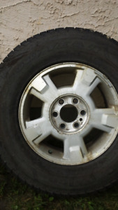 Tires and F 150 rims. 4 tires 3 rims