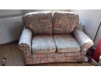 A pair of retro two seat sofas