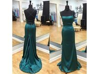 Selling this custom made ball dress. Lovely teal colour in perfect condition and never worn.