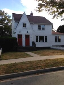 2 BR + den, character flat in duplex, available Sept. 1