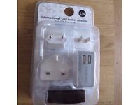 International USB Travel Adaptor - Dual USB Ports - 2.5A - For EU/USA and UK - New & Sealed