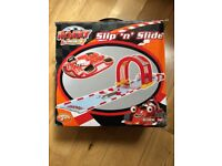 Racing Car Slip n Slide water slide. Perfect condition age 3+. Just attach a hose and inflate.
