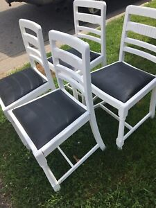 Set of 4 black and white chairs