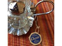 A Mayell Product Stainless Steel and Crystal Condiment set