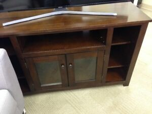 ASHLEY HARPAN WOOD TV STAND $120.00 + TAXES