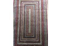 Multi coloured modern large rug.