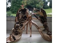 Golden winged heels (just under 4 inches)