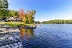 Cottage with acres of privacy, panoramic lake views.