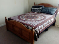Doble size hardwood bed, (very good condition) for sale in center of Bath.