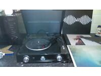 black record player with records in good condtion