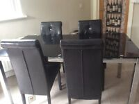 BLACK/CHROME TABLE AND FOUR CHAIRS