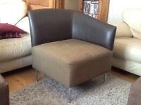 Brown faux leather chair with with chrome legs.