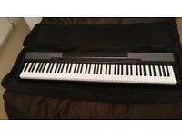 Casio CDP-100 Electric Piano In Excellent with sheet music