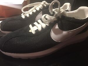 Brand new men's Nike Roshe athletic shoes