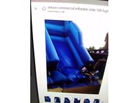 DELUXE COMMERCIAL INFLATABLE SLIDE IN EXCELLENT CONDITION.