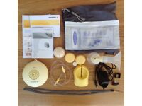Madela swing breast pump and accessories