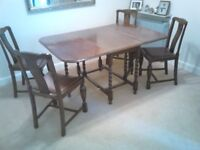 Old fashion sturdy dark wood table and 4 chairs FREE Buyer collects Cheltenham