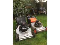 Rotary petrol lawn mowers