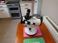 white table top telescope