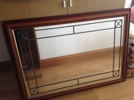 Beautiful large light mahogany embellished mirror
