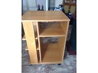 3 sided wooden unit on wheels