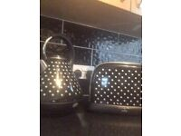 Black and white polka dot toaster and kettle