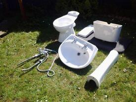 Toilet, pedestal handbasin inc taps also bath taps with shower attachment
