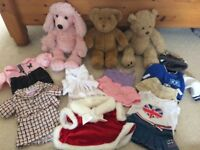 Three build a bears with a variety of outfits