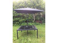 Black table with large Black Umbrella/Parasol