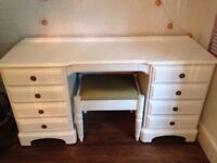 White dressing table with 8 drawers. Comes with a matching stool.