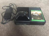 Xbox One, controller, and Resident Evil Biohazard game