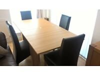 Modern light oak dining table and 4 chairs