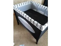 Travel cot with basinet, excellent condition, has travel bag