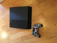 "Sony PlayStation 4 500GB ""PS4 with camouflage controller. With four games."