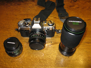 Canon AE-1 SLR with 3 Lenses.  Excellent Condition.
