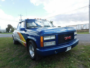 1991 GMC Sierra. Custom paint with a 350 from a Camaro with a r