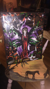 Canvas painting of angel with broken shards of mirror