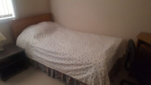used twin bed mattress with frame & wooden headboard