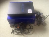 Playstation 2 (PS2) Console, 2 x Controller, 1 x 8MB Memory Card