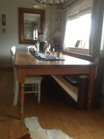 "9'11"" x 4' solid pine dining table, seats 12."