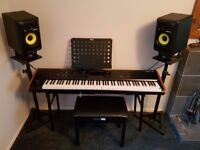 Korg Kronos 2 88 plus KRK Rokit RP6 G3 Active monitors.