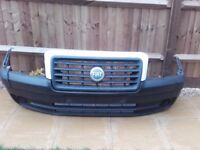 Bumper: Grill with surround: Radiator with Fan complete: Headlights