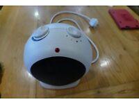 Small white electric fan heater TREAD the Globe