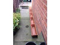 Terracotta plant troughs